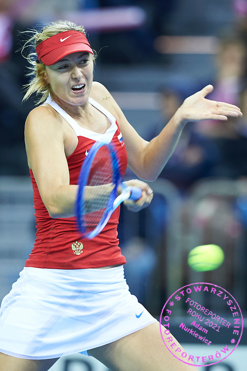 Maria Sharapova from Russia in action during First Day of the Fed Cup / World Group 1st round tennis match between Poland and Russia at Tauron Krakow Arena on February 7, 2015 in Cracow, Poland.<br /> <br /> Poland, Cracow, February 7, 2015<br /> <br /> Picture also available in RAW (NEF) or TIFF format on special request.<br /> <br /> For editorial use only. Any commercial or promotional use requires permission.<br /> <br /> Adam Nurkiewicz declares that he has no rights to the image of people at the photographs of his authorship.<br /> <br /> Mandatory credit:<br /> Photo by &copy; Adam Nurkiewicz / Mediasport