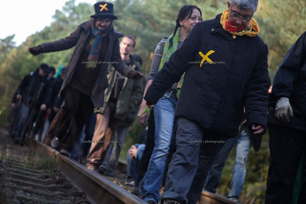 Several hundred people demonstrated today along the railway two weeks before the 12. transport of high radioactive waste is expected to arrive in Gorleben. It was part of 100 other demonstration all over Germany againt the Castor transport and germanys recent nuclear policy. Protests of tens of thousends anti nuclear activists are predicted for the early november in Lüchow-Dannenberg when the transport is supposed to be delivered from France to Germany.