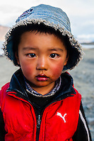 Little boy, 83 mile long Pangong Lake is the highest salt water lake in the world. It sits at 14,000 feet. 30% of the lake is in India and 70% is in China (Tibet). Ladakh, Jammu and Kashmir State, India.