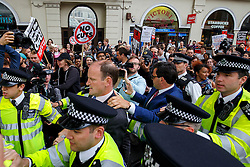 © Licensed to London News Pictures. 27/05/2015. Westminster, UK. UKIP MP Douglas Carswell surrounded by demonstrators taking part in an End Austerity Now protest outside St James's Tube station in London. Activists are demonstrating against the current conservative government and planned spending cuts. At a previous demonstration by the same group  a war memorial on Whitehall was defaced. Photo credit: Tolga Akmen/LNP