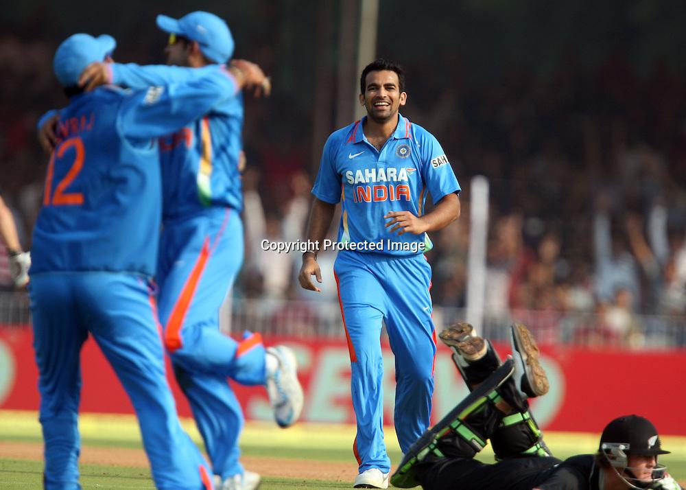 Indian bowler Zaheer Khan , Gautam Gambhir and Yuvraj Singh celebrates after Martin Guptll run out during the 3rd ODI India vs New Zealand Played at Reliance Stadium, Vadodara, 4 December 2010 (50-over match)