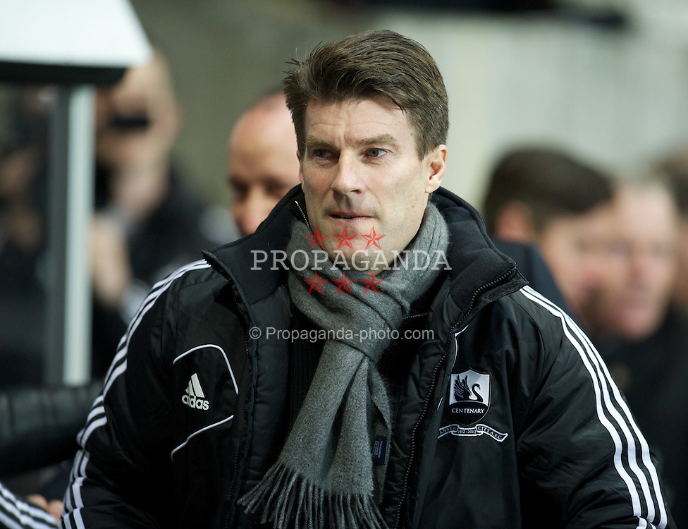 SWANSEA, WALES - Wednesday, January 23, 2013: Swansea City's manager Brian Laudrup before the Football League Cup Semi-Final 2nd Leg match against Chelsea at the Liberty Stadium. (Pic by David Rawcliffe/Propaganda)
