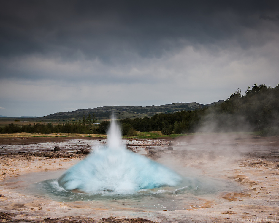 "Strokkur (Icelandic for ""churn"") is a fountain geyser in the geothermal area beside the Hvítá River in Iceland in the southwest part of the country, east of Reykjavik. It is one of Iceland's most famous geysers,[1] erupting about every 4-8 minutes 15 - 20 m high, sometimes up to 40 m high."