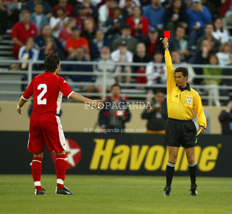 SAN JOSE, USA - Tuesday, May 27, 2003: Wales' Matthew Jones is shown the red card by referee Benito Archundia Tellez of Mexico during the 2-0 friendly International defeat by USA at the Spartan Stadium. (Pic by David Rawcliffe/Propaganda)