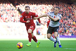 LIVERPOOL, ENGLAND - Sunday, November 11, 2018: Liverpool's Xherdan Shaqiri (L) and Fulham's Calum Chambers during the FA Premier League match between Liverpool FC and Fulham FC at Anfield. (Pic by David Rawcliffe/Propaganda)