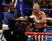 LAS VEGAS, NEVADA - JUNE 15: Referee Kenny Bayless(L) stops Tyson Fury(R) from hitting Tom Schwarz as the fight is stop in the second round at MGM Grand Garden Arena on June 15, 2019 in Las Vegas, Nevada. Tyson Fury took the win by took the win by TKO. MB Media