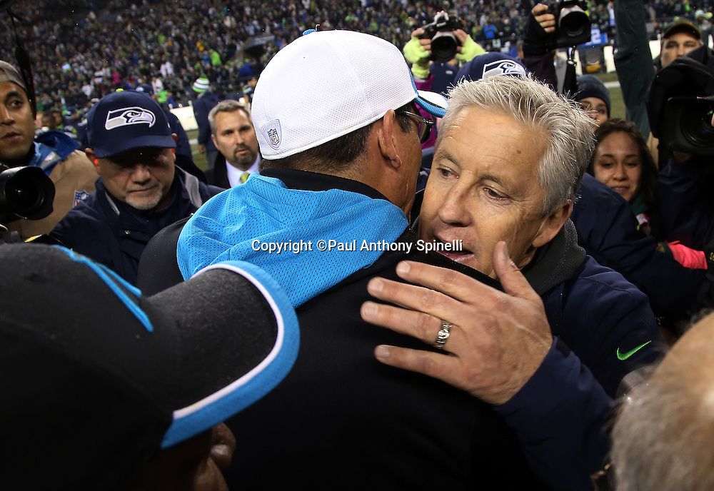 Seattle Seahawks head coach Pete Carroll hugs Carolina Panthers head coach Ron Rivera after the NFL week 19 NFC Divisional Playoff football game against the Carolina Panthers on Saturday, Jan. 10, 2015 in Seattle. The Seahawks won the game 31-17. ©Paul Anthony Spinelli