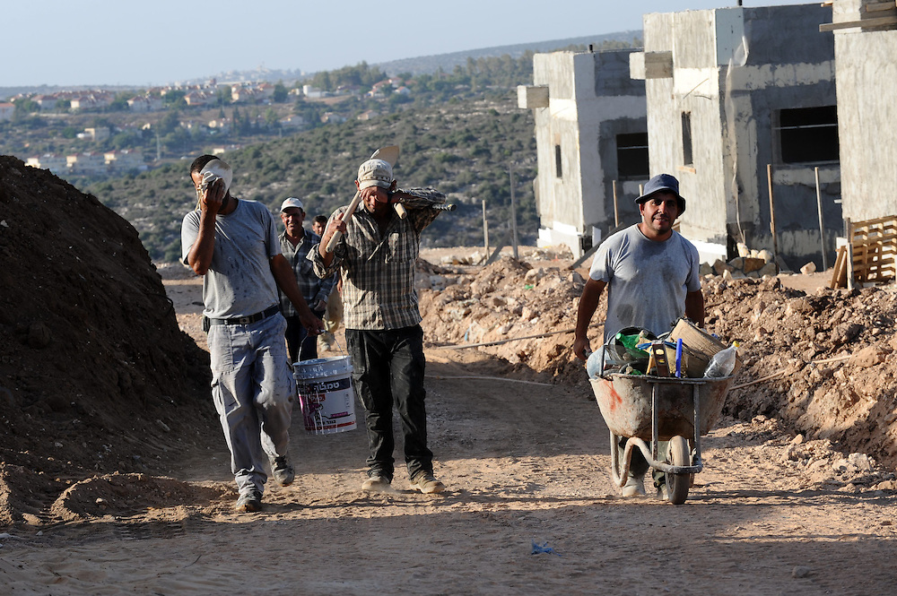 Palestinian construction workers in a construction site in the West Bank Jewish settlement of Yakir on September 27, 2010. Israel resumed construction in its West Bank settlements last night, since the 10 month building freeze had expired. Photo by Gili Yaari
