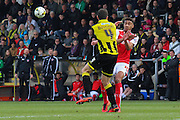 Burton Albion midfielder John Mousinho and Fleetwood Town defender Victor Nirennold come together during the Sky Bet League 1 match between Burton Albion and Fleetwood Town at the Pirelli Stadium, Burton upon Trent, England on 12 March 2016. Photo by Aaron  Lupton.
