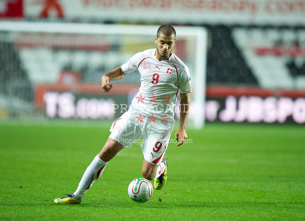 SWANSEA, WALES - Friday, October 7, 2011: Switzerland's Eren Derdiyok in action against Wales during the UEFA Euro 2012 Qualifying Group G match at the Liberty Stadium. (Pic by Chris Brunskill/Propaganda)