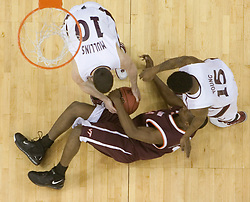 Virginia Tech Hokies guard Zabian Dowdell (1) and Southern Illinois Salukis guard Bryan Mullins (10) battle for a loose ball under the basket.  The #4 seed Southern Illinois Salukis defeated the #5 seed Virginia Tech Hokies 63-48 in the second round of the Men's NCAA Basketball Tournament at the Nationwide Arena in Columbus, OH on March 18, 2007.
