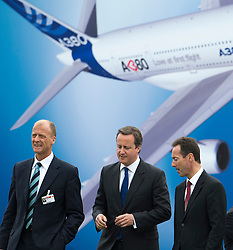 © London News Pictures. 09/07/2012. Farnborough, UK. British Prime Minister David cameron (centre) with Tom Enders, CEO of EADS (left) and Fabrice Bregier CEO of Airbus (right) on a walk round of aircraft on day one of the Farnborough International Airshow, in Farnborough, Hampshire, UK on July 9, 2012. FIA is a seven-day international trade fair for the aerospace industry which is held every two years at Farnborough Airport . Photo credit: Ben Cawthra/LNP.