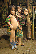 Chea Thaw with bloated stomach common to most children hiding in the jungle, near Vang Vieng, Laos, June 29, 2006.  The women and children hunt all day in the forest for wild roots and berries while the men do their best to protect them.  They usually spend about 18 hours per day just trying to find food and often go hungry.  They say the Lao army shoots at them so often they are unable to stay in one place to farm vegetables or livestock.  Many suffer digestive problems, malnutrition and starvation...**EXCLUSIVE, no tabloids without permission**  .Pictured are a group of Hmong people who report an attack against them April 6, 2006 by Lao and Vietnamese military forces.  26 people perished, 5 were injured, and 5 babies died shortly after because their dead mothers could not breast-feed them.  Only one adult male was killed, the other 25 victims were women and children (17 children).  The Lao Spokesman for the Ministry of Foreign Affairs says this is a fabrication, an investigation has been completed, and there was no attack.  The Hmong group says no officials have interviewed witnesses or visited the crime scene, a point the Lao Spokesman did not deny.  ..The Hmong people pictured have hidden in remote mountains of Laos for more than 30 years, afraid to come out.  At least 12,000 are said to exist, with little food, scavenging in the jungle. Most have not seen the modern world.  Since 1975, under the communists, thousands of reports evidence the Hmong have suffered frequent persecution, torture, mass executions, imprisonment, and possible chemical weapons attacks.  Reports of these atrocities continue to this day.  The Lao Government generally denies the jungle people exist or that any of this is happening.  The Hmong group leader, Blia Shoua Her, says they are not part of the Hmong resistance and want peace.  He claims they are just civilians defending their families, hoping to surrender to the UN..