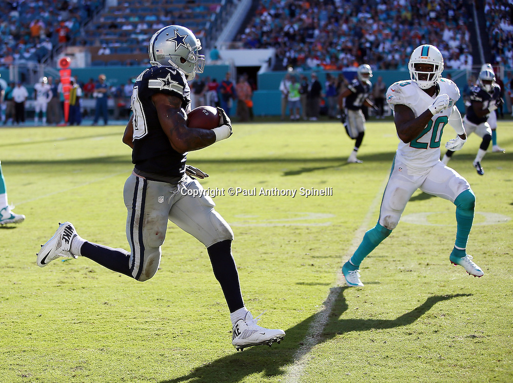Dallas Cowboys running back Darren McFadden (20) tries to elude a tackle by Miami Dolphins strong safety Reshad Jones (20) on a 35 yard run to the Miami Dolphins 9 yard line in the third quarter during the 2015 week 11 regular season NFL football game against the Miami Dolphins on Sunday, Nov. 22, 2015 in Miami. The Cowboys won the game 24-14. (©Paul Anthony Spinelli)