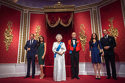 """The figures of the Duke and Duchess of Sussex in their original positions next to Queen Elizabeth II, the Duke of Edinburgh, and the Duke and Duchess of Cambridge, as Madame Tussauds London moved its figures of the couple from its Royal Family set to elsewhere in the attraction, in the wake of the announcement that they will take a step back as """"senior members"""" of the royal family, dividing their time between the UK and North America."""