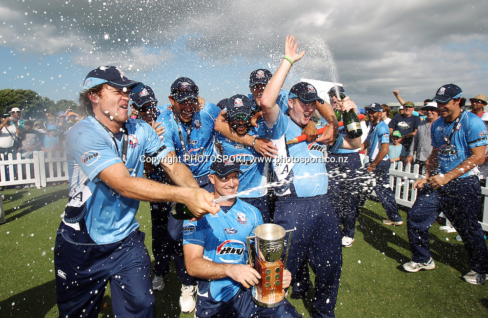 Lou Vincent sprays champagne as they celebrate victory over CD in the final of the HRV  Cup. Twenty20 Cricket, HRV Cup Final 2010/11. Auckland Aces v Central Stags, Colin Maiden Park, Auckland. Sunday 2 January 2011. Photo: Andrew Cornaga/photosport.co.nz