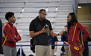 Southern California Trojans sprints coach Quincy Watts (center), talks with Kyra Constantine (left) and Kaelin Roberts during a training session prior to the NCAA Indoor Track & Field Championships in Birmingham, Ala., Thursday, May 7, 2019.