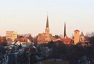 Middletown, NY - Church steeples and other buildings are illuminated by the rising sun on the morning of Dec. 24, 2007.