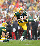 GREEN BAY, WI - SEPTEMBER 25:  Kicker Ryan Longwell #8 of the Green Bay Packers kicks a 32 yard field goal in the fourth quarter against the Tampa Bay Buccaneers at Lambeau Field on September 25, 2005 in Green Bay, Wisconsin. The Buccaneers defeated the Packers 17-16. ©Paul Anthony Spinelli *** Local Caption *** Ryan Longwell