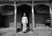 Nepal.<br /> Boy in front of his home.