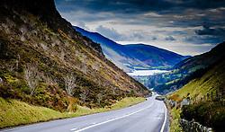 Looking down the road towards Tal-y-llyn Lake, also known as Talyllyn Lake, Llyn Mwyngil or Llyn Myngul  situated at the foot of Cadair Idris, in the Snowdonia mountain range of Gwynedd, Wales.<br /> <br /> (c) Andrew Wilson | Edinburgh Elite media