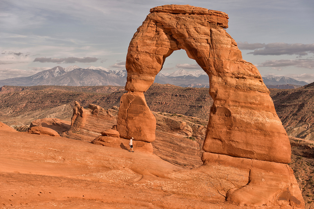 Person walking in front of Arch,Delicate Arch, Arches National Park, Moab,USA