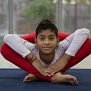 HARYANA, INDIA - APRIL, 28, 2016: Rishabh Jha, 13, who is famously known as 'Flexible Boy' practices yoga at his training center in Haryana, India. <br />