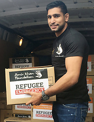 BEST QUALITY AVAILABLE<br /> World champion boxer Amir Khan with boxes of aid at his academy in Bolton, Greater Manchester as he is leading a joint campaign with the Penny Appeal and the Amir Khan Foundation to personally distribute aid to Syrian refugees in Greece.