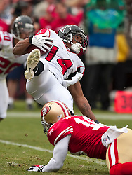 October 11, 2009; San Francisco, CA, USA;  Atlanta Falcons wide receiver Eric Weems (14) is tackled by San Francisco 49ers wide receiver Michael Spurlock (18) on a punt return in the third quarter at Candlestick Park. Atlanta won 45-10.