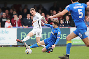 AFC Wimbledon midfielder Jake Reeves (8) tackles Northampton Town midfielder Matthew Taylor (31) during the EFL Sky Bet League 1 match between AFC Wimbledon and Northampton Town at the Cherry Red Records Stadium, Kingston, England on 11 March 2017. Photo by Stuart Butcher.