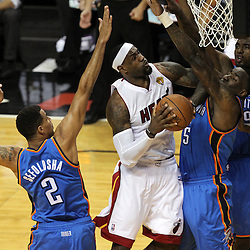 Jun 19, 2012; Miami, FL, USA; Miami Heat small forward LeBron James (6) drives to the basket against Oklahoma City Thunder center Kendrick Perkins (5) during the first quarter in game four in the 2012 NBA Finals at the American Airlines Arena. Mandatory Credit: Derick E. Hingle-US PRESSWIRE