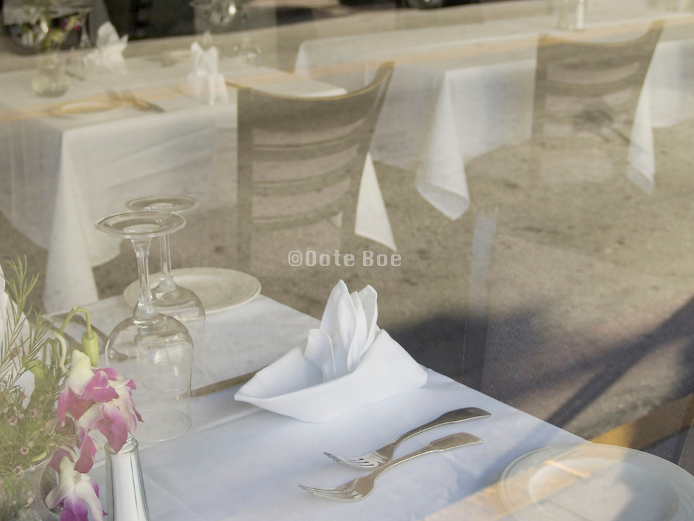 restaurant setting seen through a window