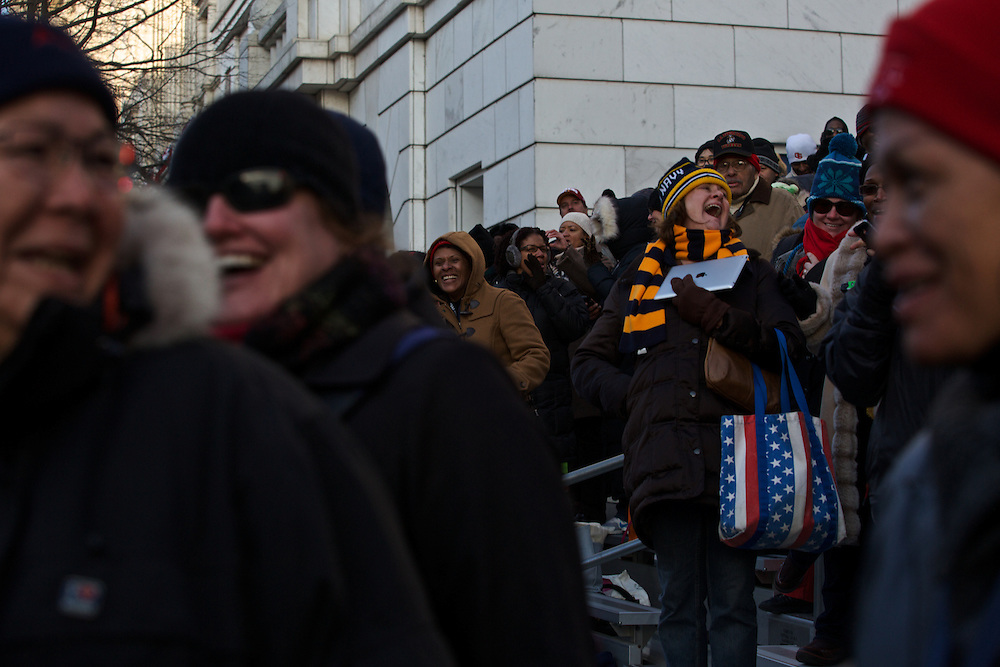 Spectators cheer for Pres. Barack Obama during the inauguration parade on January 21, 2013 in Washington, D.C.