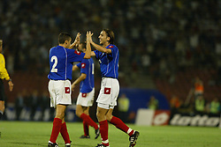 BELGRADE, SERBIA & MONTENEGRO - Wednesday, August 20, 2003: Serbia & Montenegro's Goran Gavrancic celebrates with team-mate Milivoje Cirkovic after beating Wales 1-0 during the UEFA European Championship qualifying match at the Red Star Stadium. (Pic by David Rawcliffe/Propaganda)