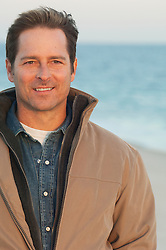 portrait of a handsome man outdoors wearing outerwear