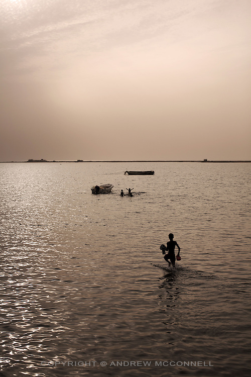 Children play in the Gulf of Aden at the port town of Berbera, Somaliland.