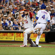 NEW YORK, NEW YORK - July 27: Wilmer Flores #4 of the New York Mets beats out the double play as Matt Adams #32 of the St. Louis Cardinals fields at first base during the St. Louis Cardinals Vs New York Mets regular season MLB game at Citi Field on July 27, 2016 in New York City. (Photo by Tim Clayton/Corbis via Getty Images)