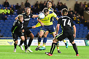 Oxford United defender Aaron Martin (6) heads at goal during the EFL Trophy match between Oxford United and Brighton and Hove Albion at the Kassam Stadium, Oxford, England on 3 October 2017. Photo by Dennis Goodwin.