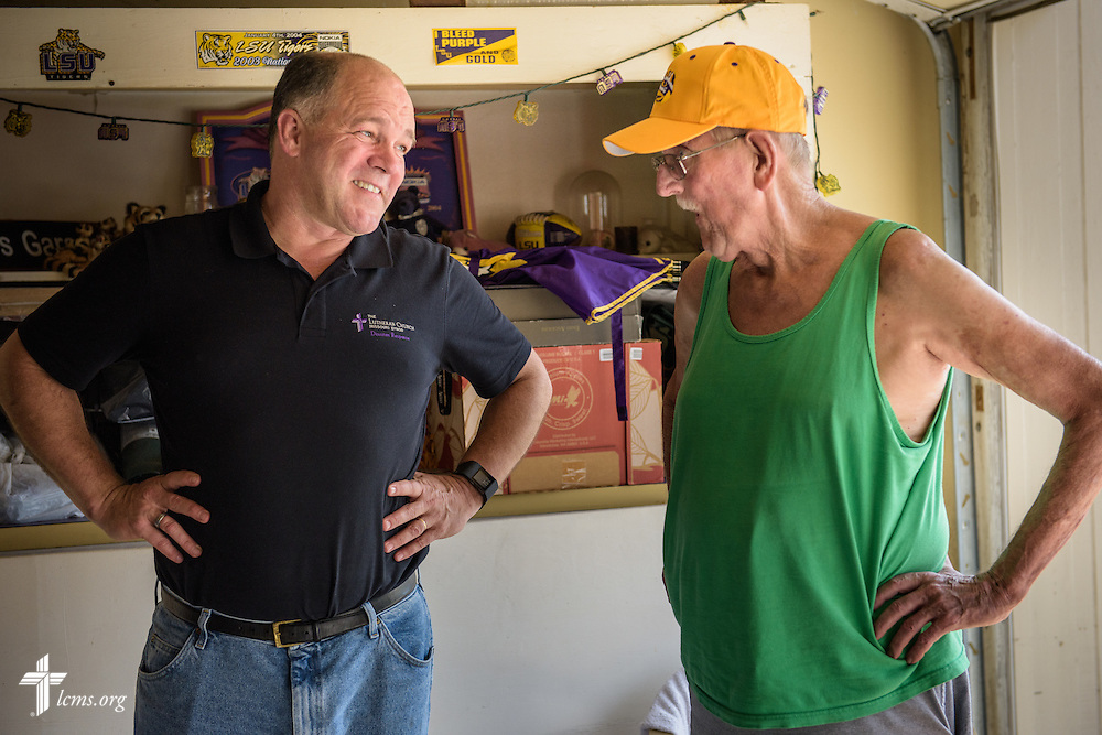 The Rev. David Buss, senior pastor of Trinity Lutheran Church, Baton Rouge, La., visits parishioner Earl Willison at his flood-damaged home on Tuesday, Sept. 13, 2016, in Baton Rouge.  LCMS Communications/Erik M. Lunsford