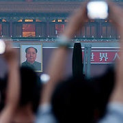 Mao overlooks tourists with digital cameras at Tien An Men square, Beijing