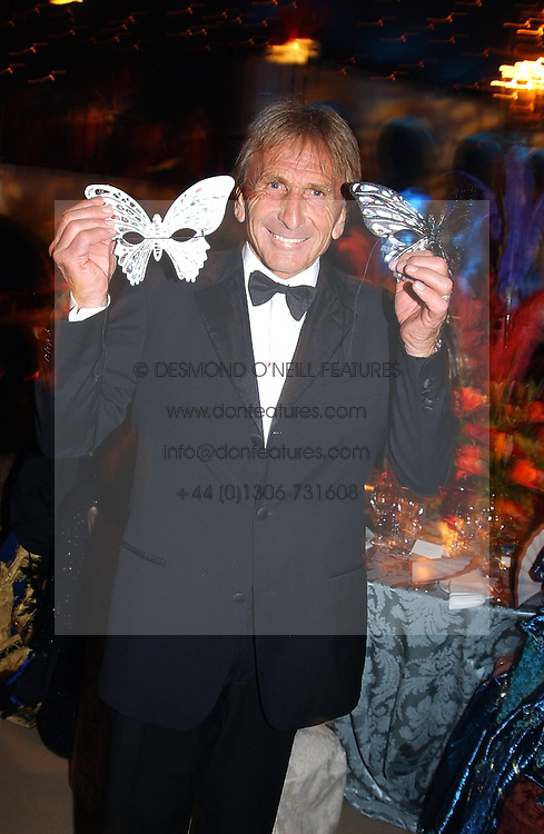 Racing driver DEREK BELL at the 2004 Goodwood Revival ball this year theme was a Venetian Masked Ball, held at Goodwood Motor Racing circuit, West Sussex on 4t September 2004.