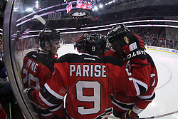Jan 31; Newark, NJ, USA; The New Jersey Devils celebrate New Jersey Devils left wing Zach Parise's (9) goal during the second period of their game against the New York Rangers at the Prudential Center.
