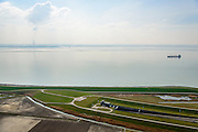 Nederland, Zeeland, Zak van Zuid-Beveland, 01-04-2016; noordelijke ingang Westerscheldetunnel met N62en zeedijk Westerschelde. Ten westen van Ellewoutsdijk.<br /> Northern entrance Westerschelde tunnel. <br /> <br /> luchtfoto (toeslag op standard tarieven);<br /> aerial photo (additional fee required);<br /> copyright foto/photo Siebe Swart