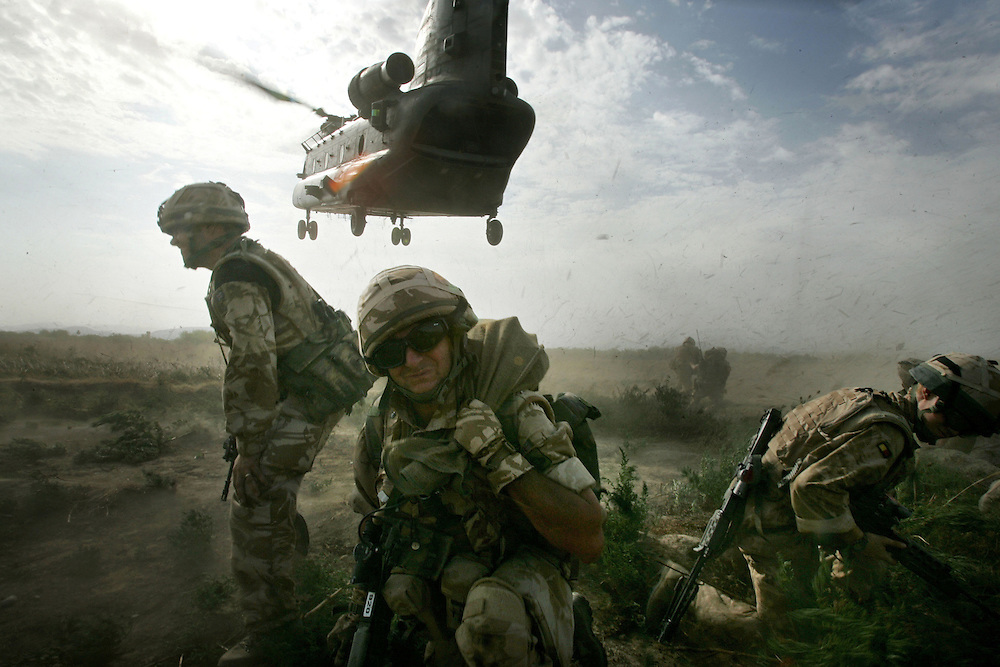 29/06/07..Sangin Valley, Helmand, Afghanistan..Soldiers from A Company 1 Battalion Royal Anglians, known as 'The Vikings' hunker down as a Chinook helicopter comes in to evacuate the injured from the frontline whilst conducting operations against the Taliban in the Sangin Valley, Helmand province, Afghanistan on the 29th June 2007...The soldiers made a Tactical Advance to Battle over night carrying just food, water and ammunition. At first light they moved on their objectives; a series of compounds, orchards and paddy fields. During the day they exchanged fire with the enemy on a number of occasions. 13 Taliban were killed, 1 British soldier and 3 Afghan troops were wounded...