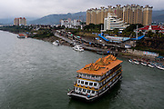 A floating restaurant and leisure ship floats down the Lancang (Mekong) in Xishuangbanna, Yunan, China.
