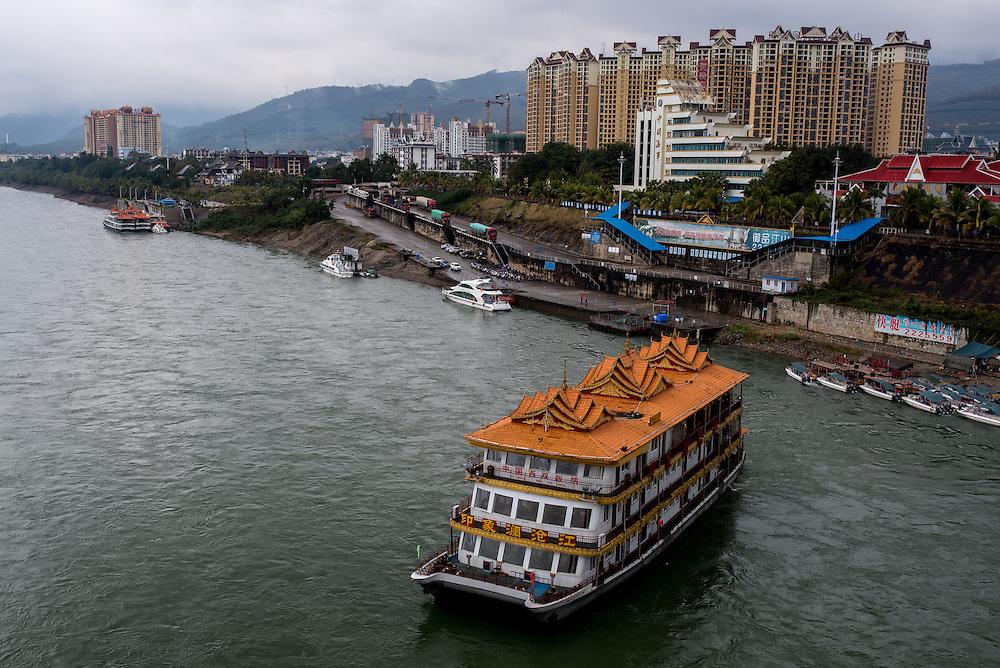 A floating restaurant and leisure ship floats down the Lancang (Mekong) in Xishuangbanna, Yunan, China.