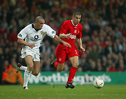 CARDIFF, WALES - Sunday, March 2, 2003: Liverpool's Milan Baros takes on Manchester United's Mikael Silvestre during the Football League Cup Final at the Millennium Stadium. (Pic by David Rawcliffe/Propaganda)