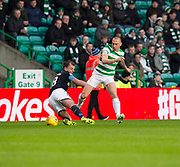 4th April 2018, Celtic Park, Glasgow, Scotland; Scottish Premier League football, Celtic versus Dundee; Scott Brown of Celtic brings down Paul McGowan of Dundee
