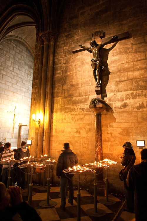 Visitors observe a crucifix inside Paris' Cathedral of Notre Dame