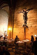 Visitors observe a crucifix inside Paris' Cathedral of Notre Dame